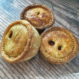 a selection of small pork pies made by dales butchers