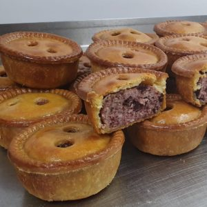 a stack of award winning pork and black pudding pies made by Dales Butchers Cumbria