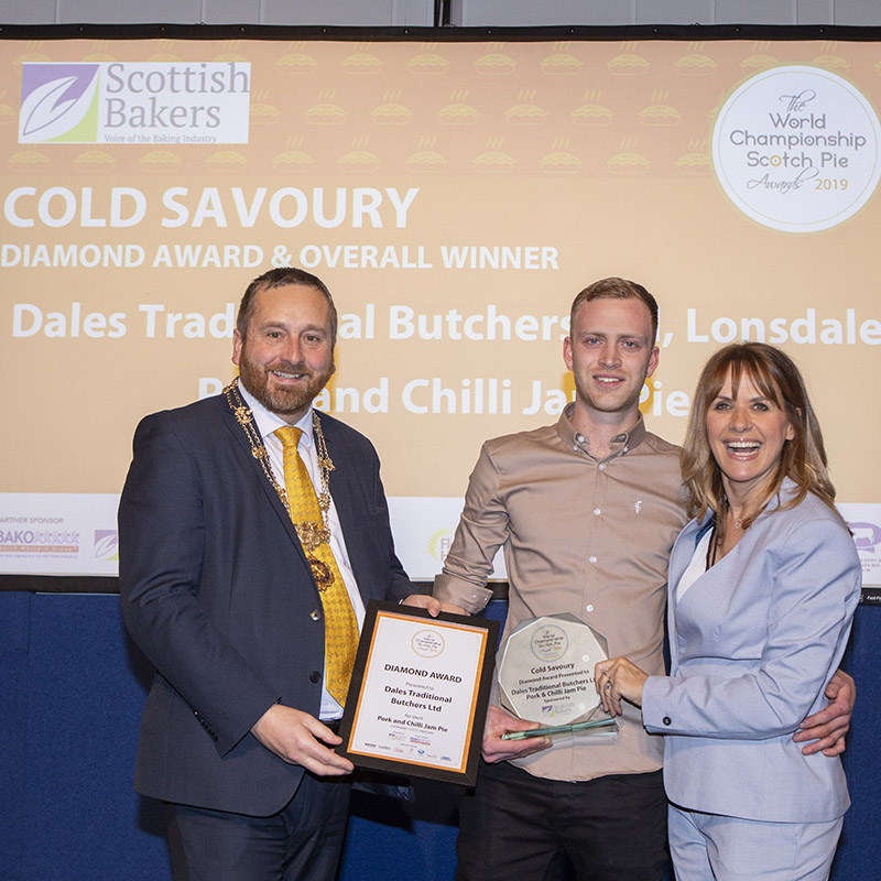 Dales Butchers team-member, Ira Collier collecting the top, diamond award for the 'Best Cold Savoury' at the World Scotch Pie Awards 2019